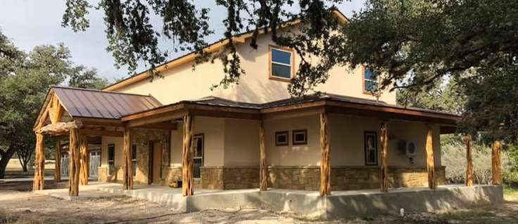 Exterior of two-story custom home built by Ideal Place in Uvalde, TX